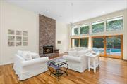 Light-filled turnkey contemporary home with pool, tennis, and basketball court. Cheerful open plan great room, dining area, and kitchen. First floor includes an en-suite master with sliders opening onto spacious deck and pool, three additional bedrooms, and two baths. Second floor features two bedrooms, one bath, and a private deck. Full finished basement expands your entertainment options. Quogue taxes and Quogue school.
