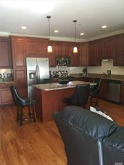 Beautiful first floor unit in the lovely South Shore Villas features open floor plan, two bedrooms, two full baths, laundry room, and full oversized basement!