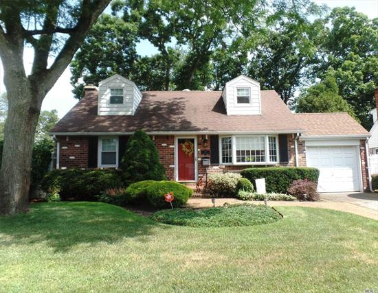 ONE OF A KIND REAR DORMERED EXP CAPE. OVERSIZED 60 X 135 LOT. OPEN FLR PLAN. INTERCHANGEABLE LAYOUT FDR OR LIV RM. LG EIK W/CENTR ISLE & S/S APPLCS. GORGEOUS SUN FILLED GREAT RM. EXT W/CATHEDRAL CEILINGS, SKYLITES & FRENCH DRS TO PARK LIKE PVT PVC FULLY FENCED YD W/PAVER PATIO & BRICK SIDE PATIO. 2 BRS W/HARDWOOD FLRS & FULL HALL BTH. 2ND FLR:2 LG REAR DORMERED BRS & UPDTD HALL BTH.BEAUTIFULLY HEATED FIN ENTERTAINING BSMNT W/CERAMIC WOOD LOOK TILED FLR. 1 CAR ATT GARAGE, IGS, MID BLK. MUST SEE!