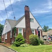 LOW TAXES! Large, Charming, brick 3-4 bedroom cape with hard to find 2 car garage. Great location! Quiet Street 1-2 blocks to Village shops/dining, train, Downing Elementary School and Library. Hardwood floors, Large living room with Gas Fireplace, Formal dining room, gas heat and stove, Updated kitchen with granite, updated baths, heating, windows and roof. Great home! Don't miss it!