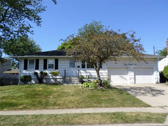 Well Maintained Ranch in the Village! Updated Kitchen, 3 BR, 2 Bth, FLR, EIK, Partial Finished Bsmt and Large 2 Car Garage! Carpets Removed Exposing Hardwood, Just Pick Your Color! Close to Shopping, Restaurants, LIRR. As-Is. Won't Last!