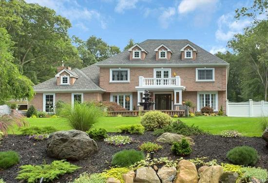 Welcome to your dream home. This magnificent 6 BR Brick Colonial is nestled on 1.16 acres of lush landscape & a backyard full of amenities! Featured on Open House NYC this home offers a Lifestyle! Gourmet kitchen has $100, 000 worth of appliances & each room has exotic wood, Inca Gold Granite or Red Onyx flooring. Enjoy your private theater or outdoor paradise featuring a sports court, pergola den w/ fireplace or pool with hot tub, waterfalls & full cabana! SD #5 Vanderbilt, Candlewood, HHH West.