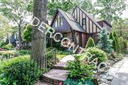 Mint 3 bdrm 2 bath Tudor in the Woods! Vaulted Living Rm w/gas fireplace, Granite/Stainless EIK, FDR, Family Rm w/siders leading out to beautifully landscaped yd w/pond! Vaulted Master Suite, Finished basement w/gas fireplace and separate laundry room. Detached Garage, Wood Floors, CAC, IGS, 200 amp electric.Great House! Great Block!!