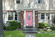 Beautiful center hall Colonial on a premier block in the Westwood section of Malverne! Curb appeal on the outside, open floor plan on the inside. This home has been renovated for modern living with a chef's kitchen + dining area open to great room w/ fireplace. French doors provide easy entertaining flow onto the inviting patio. Across from beautiful Westwood Park and LIRR station!