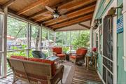Seasonal Cozy Cottage Tastefully Done & Partially Furnished! This Cottage Features A Screened front Sitting Porch, Living Rm Open To Eik W/Vaulted Ceilings W/Accent beams, Tiled Bath Rm, 2 Bedrooms, Back Private Deck, PLENTY Of Parking In Your Own Private Driveway, Shed with Laundry, & Room For Your Beach Chairs & Storage. Stroll To Beach Or Go Enjoy The Many Other North Fork Attractions: Wineries, Golf, Splish Splash, & Horseback Riding. Land Lease-$6058.04/Yr.Cash Sales- Perfect Vacation Home