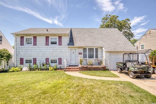 Split Level Home. Features include a Modern Kitchen with Stainless Steel Appliances. Additional features include a Large Living room, Dining room, Finished Basement, Generous Sized Master Bedroom and a spacious yard. Low Taxes & More. House being sold As-Is