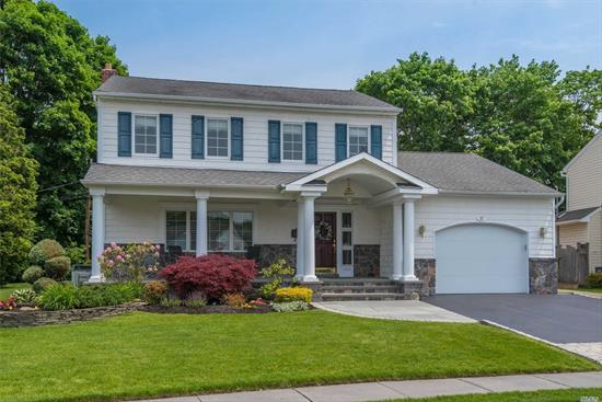 Beautiful 3-Bd, 2.5-Bth Expanded Colonial. Spacious rooms, gleaming wood flrs, Anderson &custom mouldings. Light & bright Maple/Granite eat-in kitchen w/gas cooking, breakfast bar & expanded eating area. Expanded Dining Rm. Expanded Den w/gas fpl & sliders to yard. Expanded master bdrm w/full bath & WIC. Finished basement. Updates incl CAC, baths, W/D, Boiler, HW Heater, 200 Amp, front porch, roof, siding & more. Private yard w/paver patio. Taxes Grieved-6.6% reduction as of 10/2019.