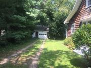 Charming Cottage in The Heart Of Stony Brook Village . Spacious Rooms, Large Front Porch, Private Backyard. Detached Garage
