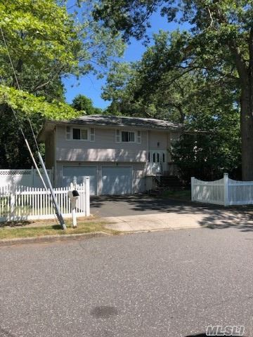 This Home Needs major renovations. Kitchen, Roof, Windows, Cesspool All Done Within 10-Years. Nice Sized Yard With Vinyl Fencing. No Representations On In-Ground Pool. Home Being Sold AS-IS!