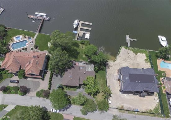 Huge price reduction! Amazing opportunity to renovate/build your Hewlett Harbor Waterfront Dream Home. No need to spend hours driving to the Hamptons! Close to NYC, This large waterfront property has Amazing Sunset views over the water. 122' of good bulkhead with rare sandy beach area at low tide extra large dock w/ boat lift and jet ski docks. Sold As-Is. It has been sitting for years vacant. Needs repairs. Come renovate/build your dream waterfront compound!