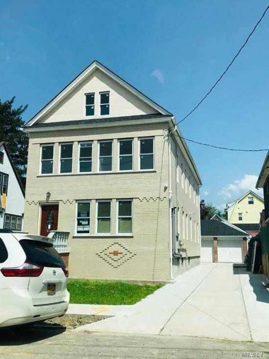 Two family . Everything are new from top to bottom. Brand new Renovated, Blocks away from Norther Blvd. 3 Car Garages with Private long driveway. sept water, elec & gas meters, good investment property. Close to LIRR