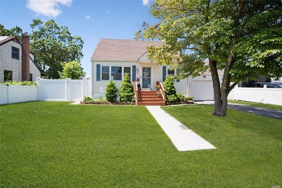 Lovely Lindenhurst! Charming Cape Close To The Beach. Featuring Four Bedrooms And One Full Bath, Eat In Kitchen That Leads To Deck And Fenced In Yard. Beautiful Hardwood Floors Throughout, Partial Finished Basement, Brand New Roof And PVC Fence. Close To Village And Railroad A Commuters Dream! Don't Miss The Open House. This Home Wont Last!!