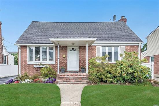 *LOOK NO MORE* ! Beautifully Updated Back Dormered 4 Bdrm Home in the Heart of Herricks! Bright & Sunny Lvng Rm! Entertainment Size FDR! Updated EIK w/Blt-In Table & New Cabinets! Lge Family Rm w/Soaring Ceilings, Gas FPL and Glass Doors leading to a Manicured Yard with a Retractable Awning, PVC fencing and a Trex Deck! 2 Updated Baths - 1 w/ a Laundry Chute! CAC! Gas Comes into the House! All Hardwood Flrs! Black Top Driveway leading to 1.5 Garage! Mostly New Windows! Cedar Closet! WOW!!