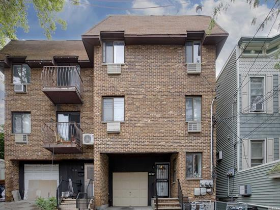 Brick Townhouse Style three family. Two Large three bedroom two bath units (1000 sq. ft) with balcony. Wood floors throughout. Updated kitchens and baths. First floor hosts a sweet one bedroom, living room, updated kitchen and bath with a private patio. Heated one car garage with private driveway. Garage access from foyer. Finished lower level living space with tile floors and plenty of room for storage. Public transportation, shopping and highways nearby.Excellent investment property!
