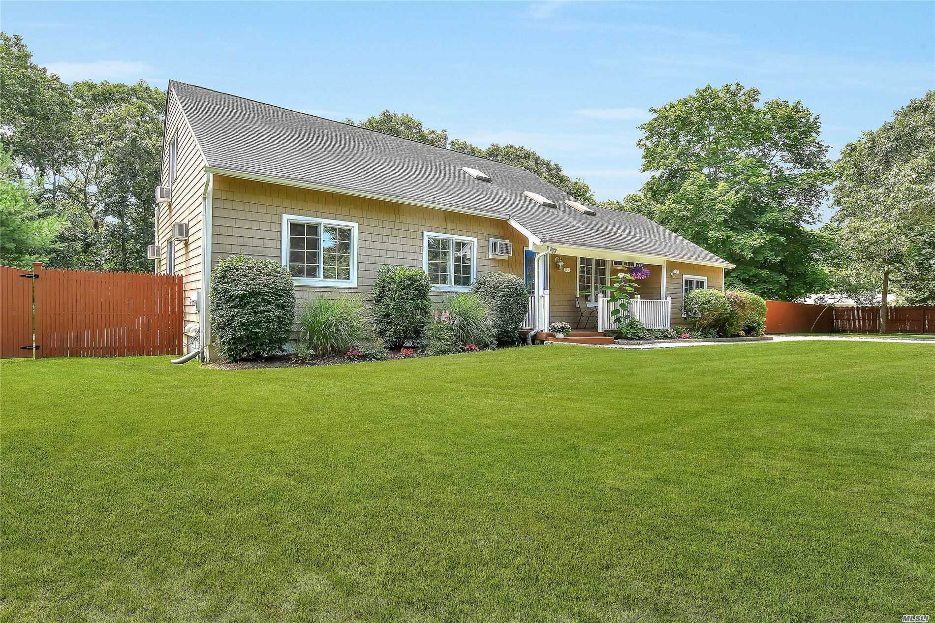 Beautiful two story home set on park like grounds.Its Hamptons living at its best! As you enter flow into the open plan family room, kitchen and views of the spacious pool sized backyard.Also on the first floor are Three Bedrooms, Jacuzzi bath and access to a large finished basement. Upstairs boasts two guest bedrooms, a hall bath, with plenty of storage. Large decking, solar heated pool, outdoor shower Call for a private Showing today Newly listed 695, 000