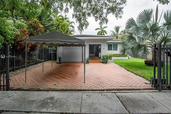 Prime North Coconut Grove Location. Beautifully Maintained 3/2 With A Nice Floor Plan And  Gleaming Wood Floors. New Tile Roof, New Impact Windows, New Electric Gate, Updated Kitchen. Large Family Room, And Formal Dining For Memorable Gatherings. The Yard Is Totally Fenced In For Your Pets And Children. 1 Car Garage And Canopy Parking.  A Short Distance To Restaurants, Movies, Marinas. The House Next Door Is Also For Sale. 2/1 $625, 000 3040 Calusa Street. Same Owner.