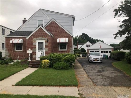 This large village cape in nestled on a beautiful oversized 5600 sf lot. Huge private driveway leads to a 400 sf 2 car detached block garage that sits next to a lovely landscaped spacious yard. Home features 4 bedrooms, full basement, 1 1/2 bath and an updated heating system. Amazing commuter location between 2 LIRR stations. Enjoy school district #16, shopping and many parks all closely located.