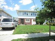 OCCUPIED WITH NO ACCESS! 164-29 98th St is a Legal two family property available for sale in the Howard Beach section of Queens. This property has 2, 2888 Sqft of living space and sits on a 40X100 lot, features 10 rooms, 4 bedrooms and 2.5 baths. Each unit offers living room, dining room, 2 bedrooms, kitchen and full bath, private driveway, carport, full basement and large rear yard. Close proximity to Community Park, transportation and shopping. Please do not disturb occupants at any time!