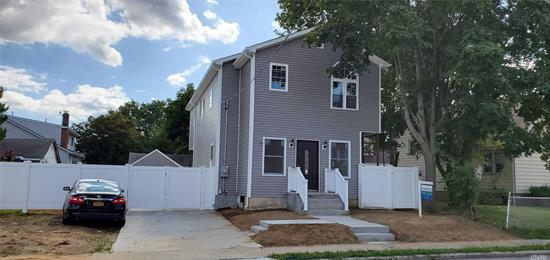 Stunning 4 Bedroom Colonial 2.5 bath, Hardwood Floors, Beautiful Kitchen with Island and Stainless Steel Appliances, Master Br with Its own Private Bath, 2 AC Zones , Gas Boiler, Fully Fenced. Washer and Dryer Hook up.