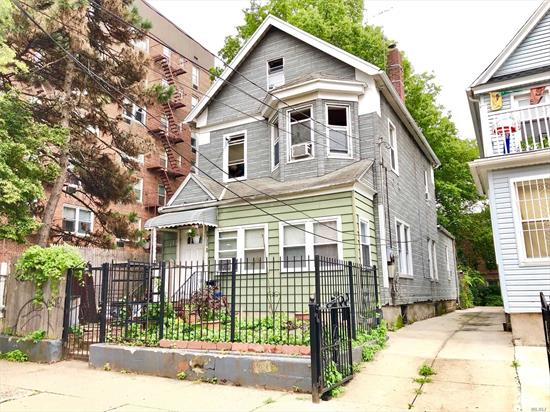 Detached Large Legal 2 Family Frame House In The Heart Of Elmhurst. Featuring 4 Beds, 2 Full Baths, 1 Half Bath, Full Basement And Attic. R5 Zoning. Close To Transportation (Buses/Subways: Q53, Q58, Q60 / M, R), Restaurants, Schools, Supermarkets, Malls And Shopping Centers. Won't Last!!!