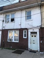 7 bed 3 bath attached brick 2 family. needs TLC but great investment opportunity for handyman or investor. Cash offers only