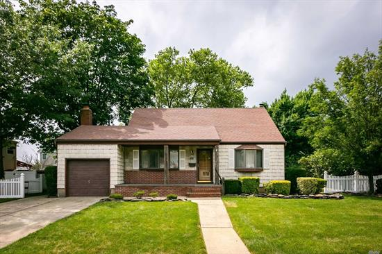 Expanded Cape with front porch, Mid-block location, Beautiful hardwood floors, CAC, Fireplace, 4 Skylights, Finished Basement, oversized property (80 x 100), Brand New Washer/Dryer, IGS, Woodward Parkway Elementary School