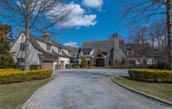 Spectacular opportunity to live in one of Old Westbury's finest gated estates in the most desired section of Round Hill. Oversized rooms with natural light, soaring ceilings and the highest level of workmanship. Boasting 2 Mstr suites, guest wing, pool, & sport court.Close to private schools and country clubs.