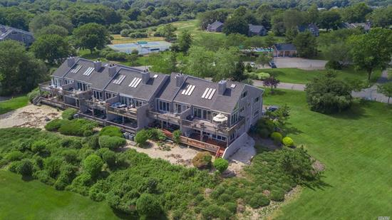 Elegant, Stunning, and Gorgeous UPPER END UNIT in Sought after Harts Cove! Breathtaking Views of Moriches Bay, 2 Ponds with Nature Watching Galore, & the endless Sky! Radiant Heated Floors, Magnificent Stone Fireplace, Custom Baths & Tile work throughout, Exquisite lighting & High End Kitchen! Wine Cellar is truly an artisan Crafted find! Heated Pool, Boat Slip, Horses & Tennis - What More would you Want or Need to Call Home? Be Careful what you Wish For - You Will Fall In Love! Pictures Soon!