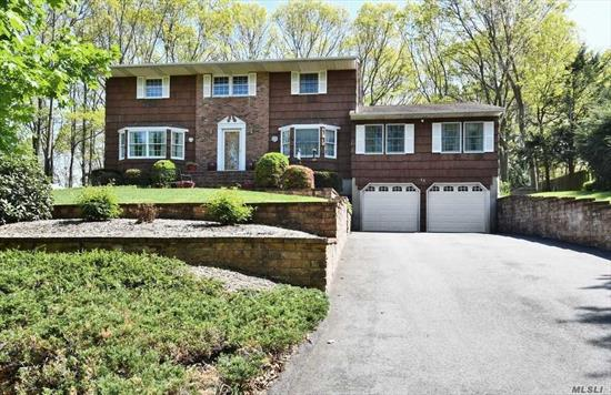 Smithtown Schools! Mother/Daughter w proper permits offers space for extended family, 2 BRs, full bath, it's own SOE & more. The main part of this expanded & spacious CH Colonial has 4 BRs & 2.5 baths. You will instantly notice it's got curb appeal galore with the grand, custom paver walkway & steps leading you to the front entry. Upon entering, it is clear that this home has been meticulously maintained by its original owners.All of this & flat, fully fenced 1/2 acre too. Beautiful neighborhood!