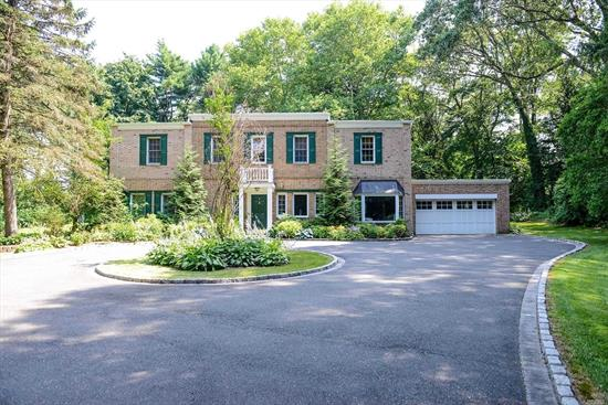 Old Brookville. Stunning Brick Colonial On Over 2 Acres On A Private Road in Old Brookville. Featuring 4 Bedrooms and 3 Full Baths, This Home Radiates Glamour, With a Recently Renovated Eat In Kitchen With Granite Counter Tops, Custom Made Cabinets And Closets, And A Patio to Playground. A Must See!