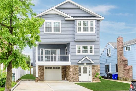Gorgeous Fema Compliant Home W/ 4 Br And 3.5 Baths. Not Your Ordinary New Construction. Beautiful Open Concept W/ a Layout That Allows Full View Through The Entire Home. No Expense Spared With High Ceilings & Crown Molding. Formal DR, Den, LR W/ FP, Huge Kitchen W/ SS Appliances And A Half Bath and 2 Huge Decks Compliment The Main Flr, Upstairs Boosts A Master Suite W/ WIC, Soaking Tub, Walk In Shower W/ Dual Heads, Finished Off W/ a Jack and Jill Bath for 2 Br's and another Bath for the 3rd Br.
