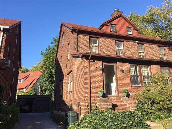 House Newly Painted and Hardwood Floors Refinished! Classic Semi-Detached Brick House! Great Neighborhood, Close To Subway And Train Station. Renowned PS 101 Q! Four Level Living Space! Hardwood Floor Throughout. New Carpet Second Floor. Wood Burning Fireplace. New LG Refrigerator and Washer & Dryer. Backyard with blue stone patio! Detached One Car Garage. Another Parking Space in front of the Garage. Street Parking Is Easy Too.