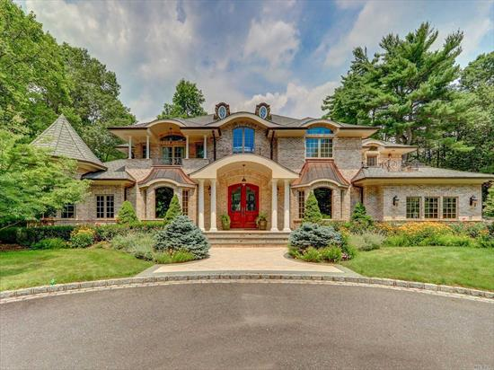 Welcome to this Sophisticated & Elegant Brick Colonial with a Gated Private Entrance Leading To The Most Elegant & Spacious Home on 2+ Acres. Chic & Custom Built Home W/Unprecedented Level Of Quality & Design. Imported Flooring, Radiant Heated Floors, Gourmet E.I.K w/Marble Counter Tops, Tailor & Detailed Built Cabinets, Doors, Railings & Moldings. Calming & Resort Like Backyard w/In-Ground Pool, Beautiful Stone Patio w/Endless Greenery; You will Forget You are Only 25 Mins. from NYC. Must See!