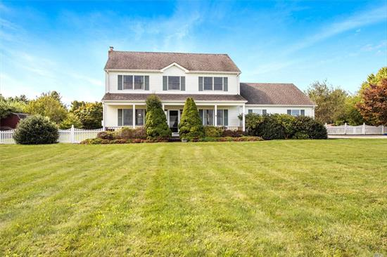 Welcome To The North Fork! Spacious 3 Bd, 2.5 Ba Colonial In The Heart Of Jamesport Offering Privacy And Beautiful Farm Views. 2-Car Garage And Full Basement With Outside Entrance. Large Fenced Yard With Pond And Gazebo Perfect For Entertaining And The Addition Of A Pool. Convenient To All The North Fork Has To Offer.