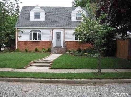 This hidden gem is on a private street. This house has a spacious LR/DR combo, an updated kitchen with a dishwasher & stainless steel appliances. It has a master bedroom on the 1st floor, & an oversized bedroom on the 2nd floor. It also has 2 full baths & finished basement with a washer /dryer. There is also a large deck outside & 2 parking spaces in the driveway. Don't miss this opportunity to live in this quaint & desirable neighborhood. It is minutes from to the LIRR & Adelphi University.