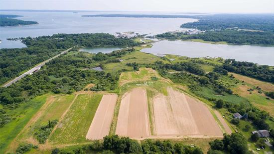 Greenport Farmland - Rare opportunity to own approximately 35 acres with 33 acres development rights sold and a 1.84 acre buildable parcel with waterviews over preserved land to Arshamomaque Pond. Bucolic setting waiting for your vision! Perfect for horses, farming, or other agricultural endeavors.