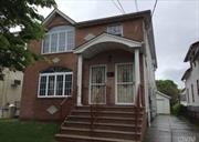Beautifully renovated detached home in Springfield Gardens with a private driveway and detached garage. Master bedroom has its own bathroom. Each unit has its own separate entrance. Walking distance to the LIRR, Locust Manor Station. Don't wait, call now!