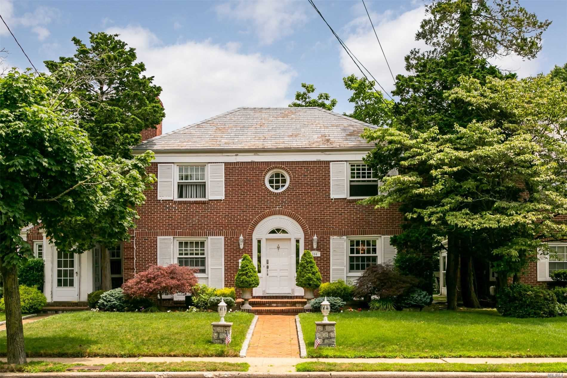 This unique & majestic all-brick colonial has high end, custom upgrades thru out. Stunning EIK w/maple cabinets, stainless applcs including wine fridge, granite counters. Sunken living rm w/Wood burning fireplace & built-ins. Mstr bdrm Ste w/2 walk in closets, bath w/double vanity & granite counters. Beautiful HW floors thru out. Two addit'l rooms ideal for home office or Au Pair suite. Upgraded 3 zone gas heat, 200 amp electric. Close to LIRR & Shopping. Too much to list..come see for yourself!