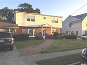 NEW PRICE REDUCTION and TAX GRIEVANCE HAS BEEN FILED WITH MAIDENBAUM & MAIDENBAUM - Expanded 5 bdrm 2 bath Colonial in the Heart of Syosset!! Large home featuring an EIK, Living Room, Den w.wood burning fireplace - room for the whole family - 2 nice rooms on the mail level for bedrooms, office or playroom and full bath. Second level features a Large Master bedroom,  two additional bedrooms and full bath. Great backyard Great Syosset School District #2