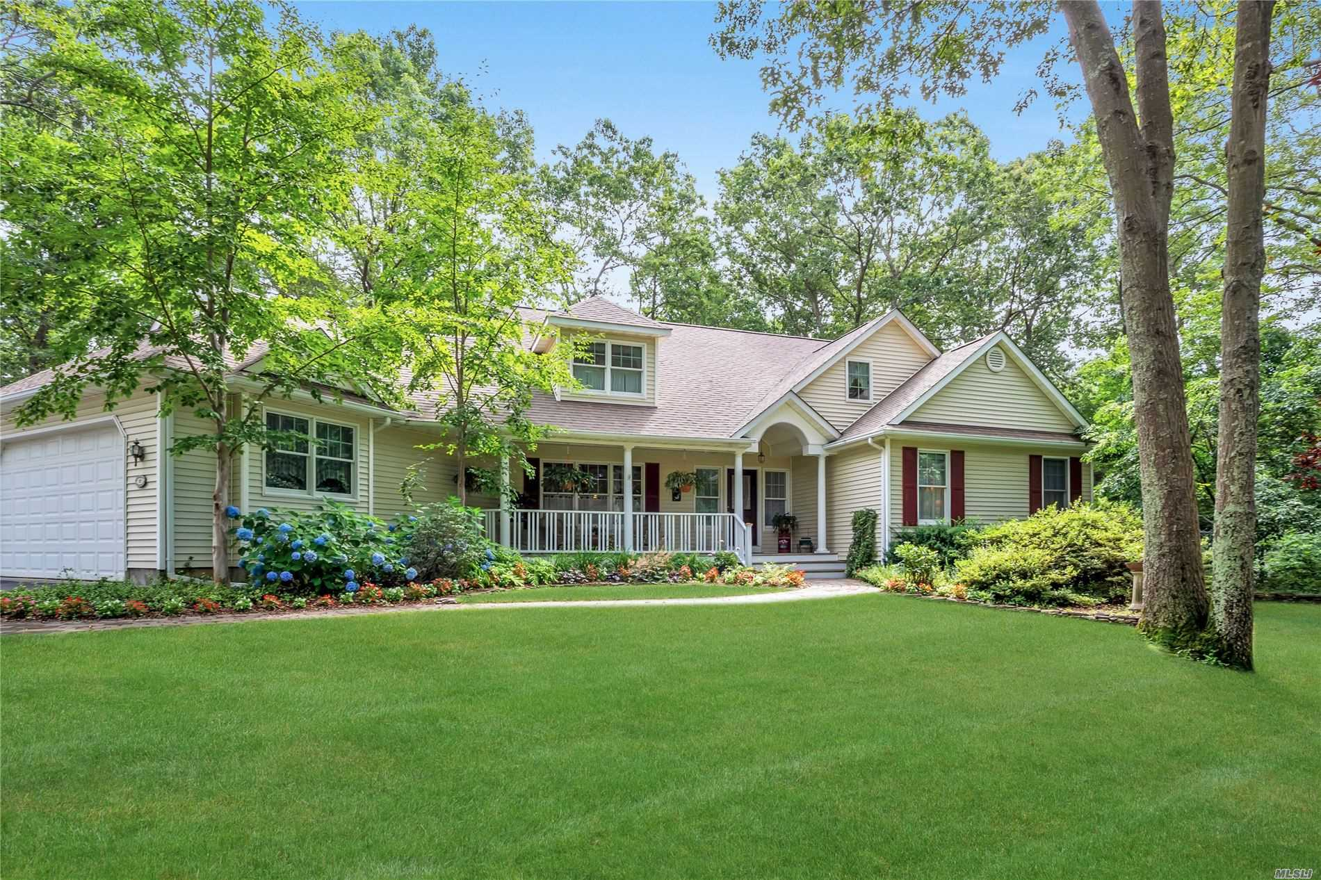 Tax Grievence In Progress. Beautiful Home In A Lovely Setting. 4 Bedroom Custom Built Cape On Park Like Grounds. All Hardwood Floors, Newly Updated Kitchen W/Quartz Counters, MBR Suite On First Floor, Very Large Rooms And Loads Of Closets. All Andersen Windows, Den W/Fireplace, Over Sized 2 Car Garage W/ 9 Foot Ceiling, New Driveway And Paver Walkway, Water Filtration System, CVAC,  Original Owner, Adjacent To Town Property So There is Lots Of Privacy. Shoreham/Wading River Schools.