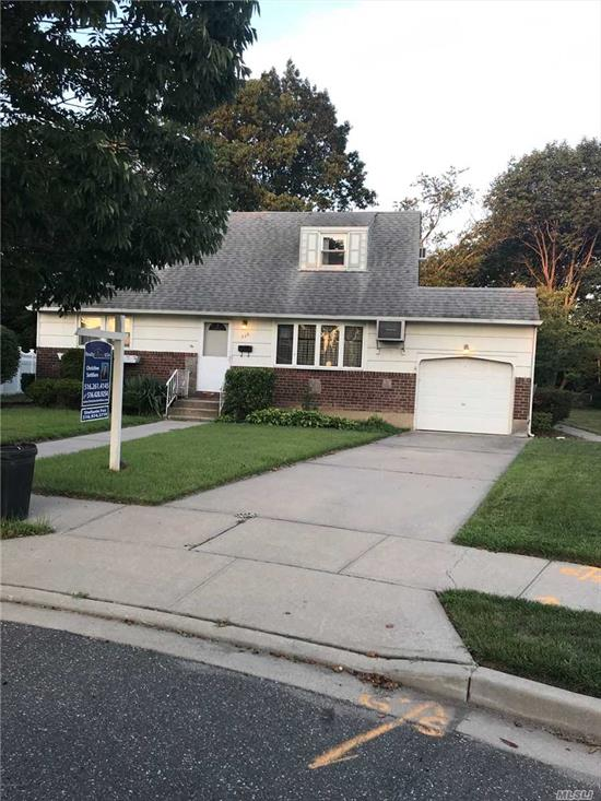 Don't Miss This Great Opportunity To Own A Charming 4 Bedroom, 2 Bathroom Cape w/Full Basement and Attached 1 Car Garage. Settled on a Quiet Cul-de-sac with an Oversized Lot. Conveniently Located To Shopping, Schools, & Transportation. Use Your Imagination and Come Make This Houses Your Dream Home. This One Won't Last!!! **Sold As Is**