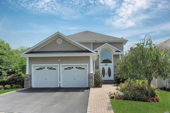 Come See Smithtown's Best Kept Secret......Must See This Beautiful 4 Bdrm, 3 Bth Colonial Overlooking the 2nd Fairway of this Desirable Gated Golf Community/Amenities! This Professionally Decorated SMART Home Has All the Bells & Whistles including an Elevator, Generator, Heated Garage, Ring Doorbell & Motion Detector/Cameras, Nest Smoke & CO2 Detectors, & Top of the Line Appliances. This Is the House You've been waiting For!