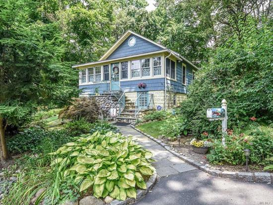 Nestled on the hillside, this 1920's bungalow is loaded with charm and convenience. All new and updated, with garage, deck, arboretum-like grounds and an outside lower level entrance. And, there is so much more to see!