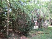 Nestled In The Woods Just Off The Main Road Offering Both Privacy And Convenience. Private Inground Pool In Rear Near Short beach