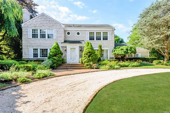 Lovely Spacious Colonial on Park Like Setting in Prestigious Hewlett Harbor Location. Large Den with Vaulted Ceiling, Radiant Heated Flooring, 2 Fireplaces, Doors in Kitchen and Den Open Onto Beautifully Landscaped Brick Patio and Heated Inground Gunite Pool. Wonderful Layout for Entertaining and Family Living.