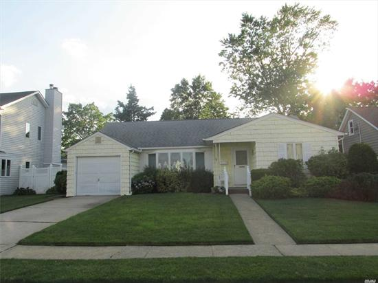 A DIAMOND IN THE ROUGH RIGHT HERE IN WANTAGH WOODS..3 BR..2 FULL BATH RANCH WAITING FOR YOUR SPECIAL TOUCH TO MAKE THIS YOUR DREAM HOME..ANDERSON WINDOWS.. HARDWOOD FLOORS THROUGHOUT..MASTER BR WITH FULL BATH AND WALK IN CLOSET..LARGE BASEMENT AND ATTIC..ATT GARAGE..MAKE THIS YOUR OWN!