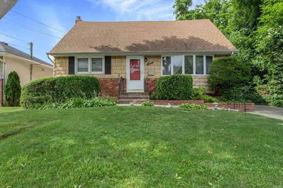 Charming, Expanded Cape Cod style home on Cul-de-sac.Featuring 4 Bedrooms, 2 Full Baths, A Large Family Rm w a Wood Burning Stove. A partially finished basement w an OSE. Located Close to LIRR, Shopping & Schools