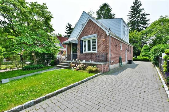 Huge expanded cape featuring 4 large bedrooms and 3 full baths. The basement is finished with very high ceilings and has a full bath. There is also an outside entrance to the basement. This property has a lovely yard. Plenty of living space and a very large kitchen. MUST SEE! WILL NOT LAST!