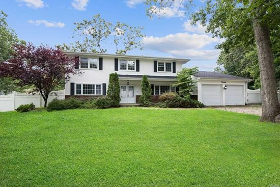 Perfectly Renovated Colonial With Gorgeous Eat In Kitchen, Hard Wood Floors Throughout, Large Den With Fireplace, Spacious Bedrooms, And A Sprawling And Tranquil Backyard With A Patio - Perfect For Relaxing And Entertaining! Just A Short Distance From Tanglewood Park, Pine Ridge Golf Club, And All Your Shopping And Dining Needs. Come See This Beauty Before It's Gone!