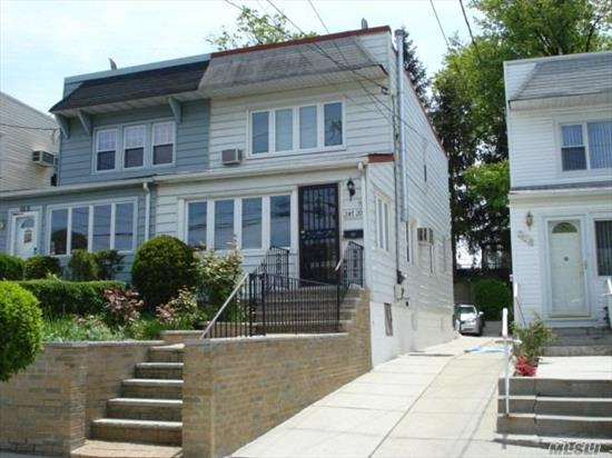 Large combination windows, elevated posture and northwest-facing makes this house very bright and inviting. Windows have lifetime warranty. Completely renovated: move right in! Open kitchen has large eat-in granite counter with tall chairs, undermount sinks, strong vented range hood, and lots of cabinets & drawers. Close to all: Northern Blvd buses, food shopping, P.S. 94, LIRR, library, restaurants, etc. Great hard wood floors throughout! Can park 2 cars in back. SD #26 schools.